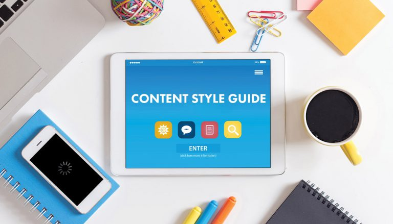 a content style guide is displayed on a desk