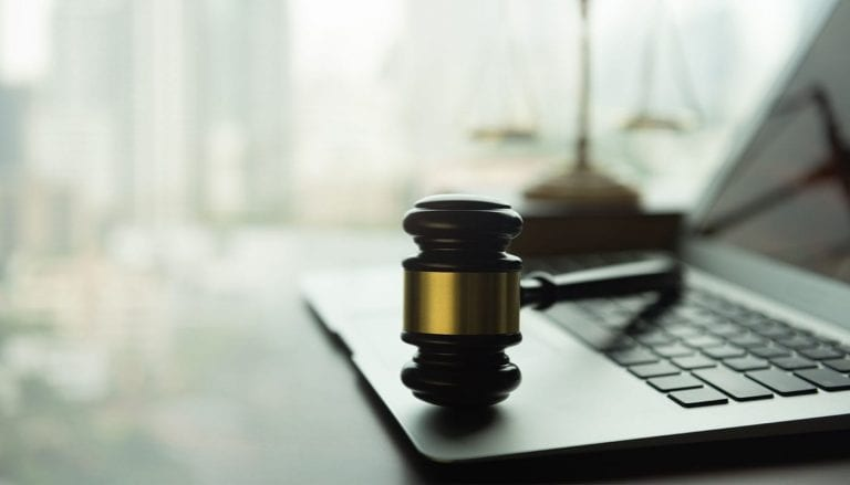 gavel sits on an open laptop