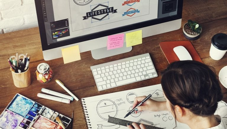 graphic designer sketching logo designs